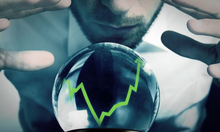 a man looking into a crystal ball for a trends forecast